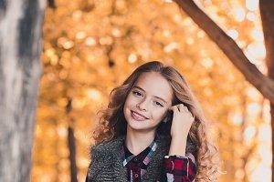 Smiling teen girl outdoors
