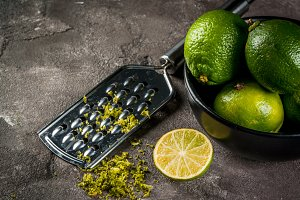 Fresh limes with grater