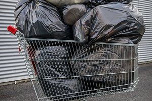 Shopping cart full of garbage bags