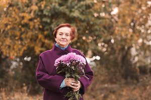 Senior woman with flower