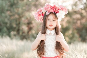 Stylish kid girl with flowers