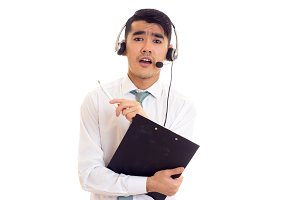 Young man in headphones holding a folder