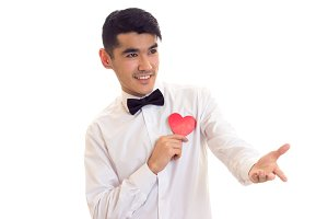 Young man holding a read heart