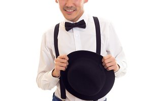 Young man with bow-tie, suspenders and hat
