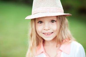 Funny kid girl over green