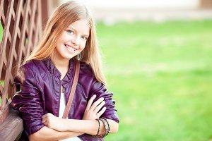 Stylish teen girl over green