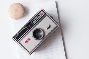 Vintage Camera & Macaron Flatlay