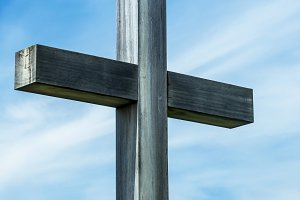 wooden cross and sky background