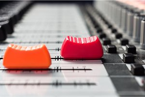 Orange and  red slider on a sound mixer