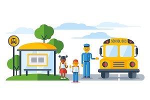 Schoolers getting on yellow schoolbus at bus stop