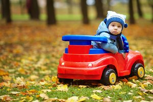 little funny boy driving toy car