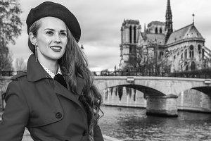 woman near Notre Dame de Paris looking into the distance