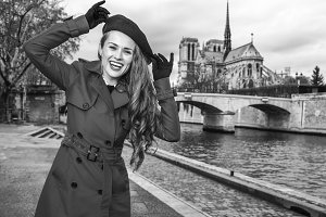 smiling woman on embankment in Paris, France having fun time