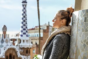 traveller woman at Guell Park in Barcelona, Spain in winter
