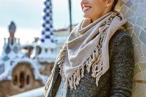 stylish woman standing in Barcelona, Spain in winter
