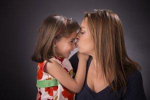 Young woman kissing girl