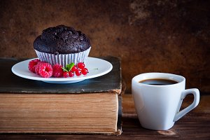 Chocolate muffin and cup of coffee