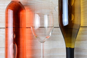 Wine Glass Between Two Bottles