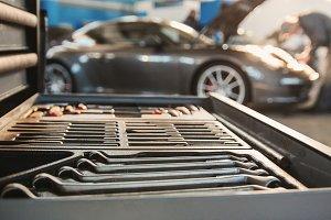 Car service - luxury sport car standing in garage