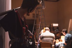 Sound engineer working on the independent cinema production - film set