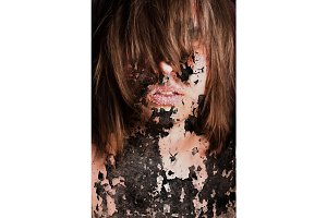 Dark art portrait of a girl with cracks and old paint