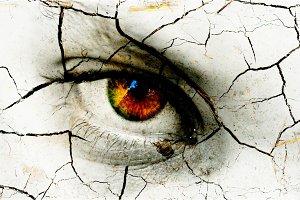 Dark art texture of a woman's eye with cracks