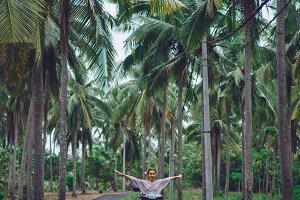 road among palm trees