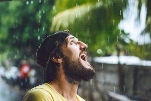 Bearded man in the rain