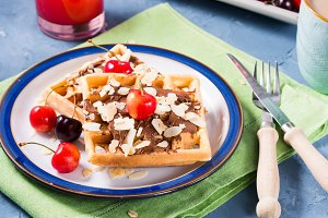 Sweet belgian waffles with chocolate almond cherries