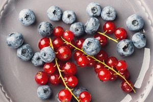 Fresh summer wild berries on rustic plate
