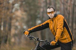 Portrait of Biker in Forest