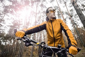 Man Rides a Bike in the Forest