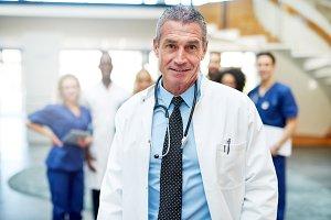 Cheerful medic standing and looking at camera