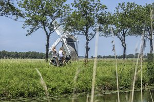 Bike girls and a windmill