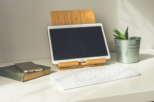 Electronic gadgets on white desk