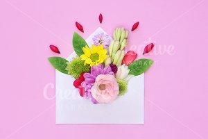 envelope full of various flowers