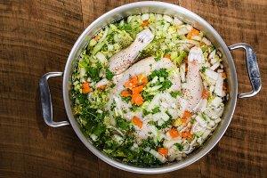 Chicken soup ingredients in cook pot
