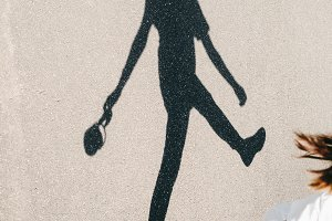 shadow of girl with headphones