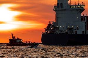 Pilot ship catches big container ship