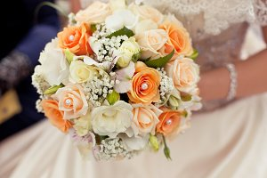 Pastel wedding bouquet in hands