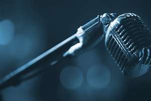 Night club scene - metal vocal microphone - blue toned