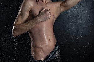 Erotic naked and wet man.