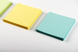 Stack of colorful paper notes. Isolated. Horizontal shoot.