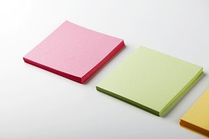 Stack of colorful paper notes. Isolated.