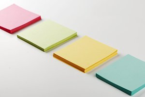 Stack of paper notes of different colors. Isolated.