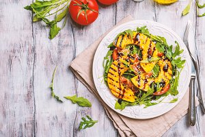 Delicious grilled pumpkin and arugula  salad