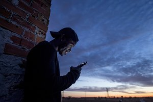 black boy looking at smartphone