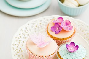 Macarons and decorated cupcakes