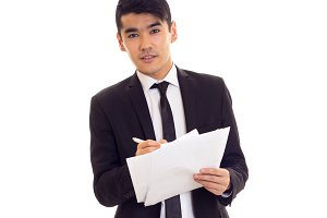 Young man in suit holding papers