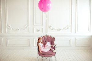 Kid girl with balloon in room